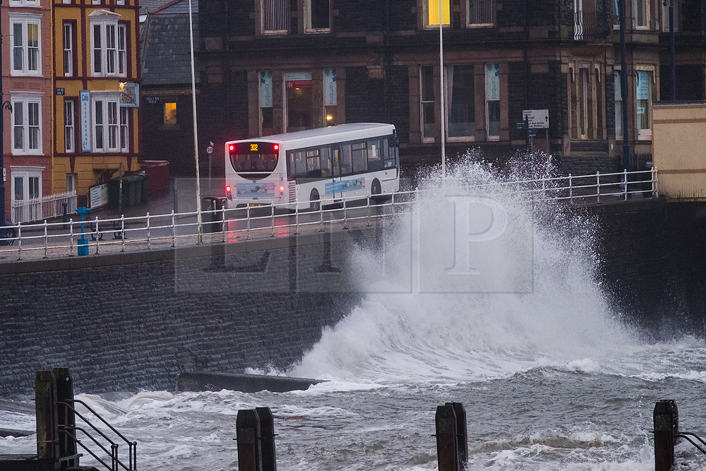 © Licensed to London News Pictures. 20/1/2017. Aberystwyth, Wales, UK. High tides and strong winds  combine to bring waves crashing into the seaside promenade in the early morning in Aberystwyth, on the Cardigan Bay coast of west Wales. Photo credit: Keith Morris/LNP