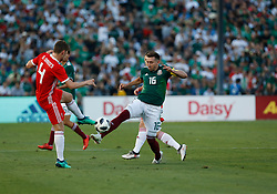 May 28, 2018 - Pasadena, CA, U.S. - PASADENA, CA - MAY 28: HŽctor Herrera of Mexico attempts a pass past  Ben Davies of Wales during the game on May 28, 2018, at the Rose Bowl in Pasadena, CA.  (Photo by Adam  Davis/Icon Sportswire) (Credit Image: © Adam Davis/Icon SMI via ZUMA Press)
