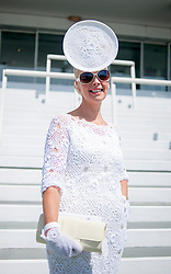 TODAY PICTURE © Licensed to London News Pictures. 06/06/2014. Epsom, UKJillian Kelliher from Cork, Ireland. Ladies Day today 6th June 2014 at Epsom 2014 Investic Derby Festival in Surrey. Traditionally, elegant, fashionable racegoers gather for a classic day's racing at Epsom Racecourse, Surrey. Photo credit : Stephen Simpson/LNP