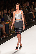 A black and gray knit skirt wih fringed hem and a white, gray and black sleeveless crop top.