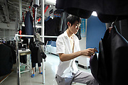 Workers make suits at a factory owned by the Baoxiniao Group on the outskirts of Shanghai, China, on 19 September, 2010. Baoxiniao is the lasrgest suit maker in China.