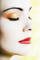 beautiful caucasian woman portrait beauty eyes closedstudio on yellow background
