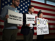 """31 OCTOBER 2019 - DES MOINES, IOWA: People protest against changes to the Affordable Care Act in the Neil Smith Federal Building in Des Moines. A small crowd of people came to the federal building, where US Senators Chuck Grassley's (R-IA) and Joni Ernst's (R-IA) offices are, to deliver a petition protesting the Senate's vote that critics say would allow """"spooky junk health insurance plans"""" with limited coverage and would allow insurance companies to deny coverage to people with pre-existing conditions.            PHOTO BY JACK KURTZ"""