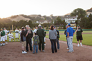 San Marin High School Athletic Director Craig Pitti (far right) seeks answers for how to resume the suspended North Coast Section Division 3 championship game between San Marin and Acalanes High on June 6, 2011. The final score remained 4-4, when NCS officials later declared both teams Co-champions.