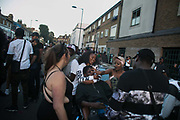 Party people having fun at the end of the carnival in Ridley Road in East London, United Kingdom,Sept 11 2016. The annual Hackney Carnival took place on a hot summers day and the procession of dancers dressed in various outfits moved through the streets to much joy of the many bystanders.