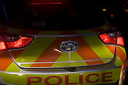 The rear of a Metropolitan Police Hyundai ix35 car is lit by headlights from another vehicle, in the London borough of Southwark.