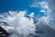 Jungfrau mountain (left) and Siberhorn (snowy triangle) in the Swiss Alps, Bernese Oberland, Switzerland