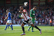 Andre Gray of Brentford celebrates after he scores his sides first goal of the game to make it 1-2. Skybet football league Championship match, Brentford v Ipswich Town at Griffin Park in London on Saturday 8th August 2015.<br /> pic by John Patrick Fletcher, Andrew Orchard sports photography.