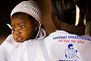Rosina Adom holds her daughter during a meeting for members of a breast feeding support group at the La Polyclinic in Accra, Ghana on Tuesday June 16, 2009.