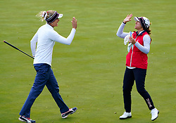 Auchterarder, Scotland, UK. 14 September 2019. Saturday afternoon Fourballs matches  at 2019 Solheim Cup on Centenary Course at Gleneagles. Pictured; Lexi Thompson and Marina Alex of Team USA celebrate after Thompson holes putt on 4th green to win hole. Iain Masterton/Alamy Live News