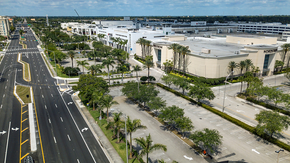 An empty North Kendall Drive and empty parking lots at Dadeland Mall at high noon as Miami-Dade County shelters in place due to COVID-19 on Tuesday, March 31, 2020.