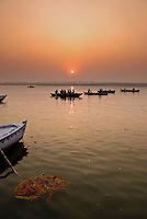Tourist boats at sunrise on the River Ganges in Varanasi, Uttar Pradesh, India