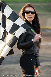 Holding the checkered flag at the Okie Dokie Vintage Races put on by Go Takamine's Brat Style at West Point Off-Road Village, Kawagoe, Saitama, Japan. Tuesday, December 4, 2018. Photography ©2018 Michael Lichter.
