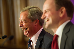 © Licensed to London News Pictures. 28/08/2014. One Great George Street, London. Tory MP Douglas Carswell announces that he is defecting to UKIP at a press conference hosted by UKIP leader Nigel Farage. Photo credit : David Tett/LNP