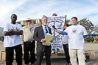 From left, homeless advocates William Silas, Van Gresham, attorney Anthony Prince, Frank Alvarado Sr. (holding sign) Elizabeth Madrigal, and Wes White in front of City Hall Tuesday.