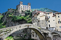 the Italian medieval village of Dolceacqua, Ligury. Above the village and the typical stone bridge the ruins of the Doria castle.