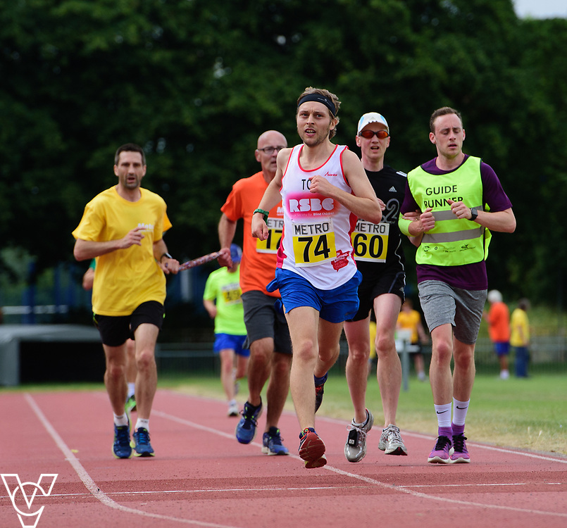 Event: 5000 meter relay<br /> Competitors, from left: David Beynon, Competitor #74, Andrew Jones and Finley Willis<br /> <br /> Metro Blind Sport's 42nd Athletics Open, held at Mile End Stadium, Tower Hamlets, London.<br /> <br /> Picture: Chris Vaughan Photography for Metro Blind Sports<br /> Date: June 16, 2018