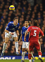 Photo: Paul Greenwood.<br />Everton v Blackburn Rovers. The Barclays Premiership. 10/02/2007. Everton's James Beattie, left clears the danger from Blackburn's Tugay, right.