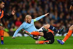 Shakhtar Donetsk''s Taras Stepanenko (centre left) fouls Manchester City's David Silva and concedes a penalty