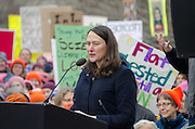 Augusta, Maine, USA. 21st Jan, 2017. Maureen Drouin, Executive Director of Maine Conservation Voters, address the Women's March on Maine rally in front of the Maine State Capitol. The March on Maine is a sister rally to the Women's March on Washington.