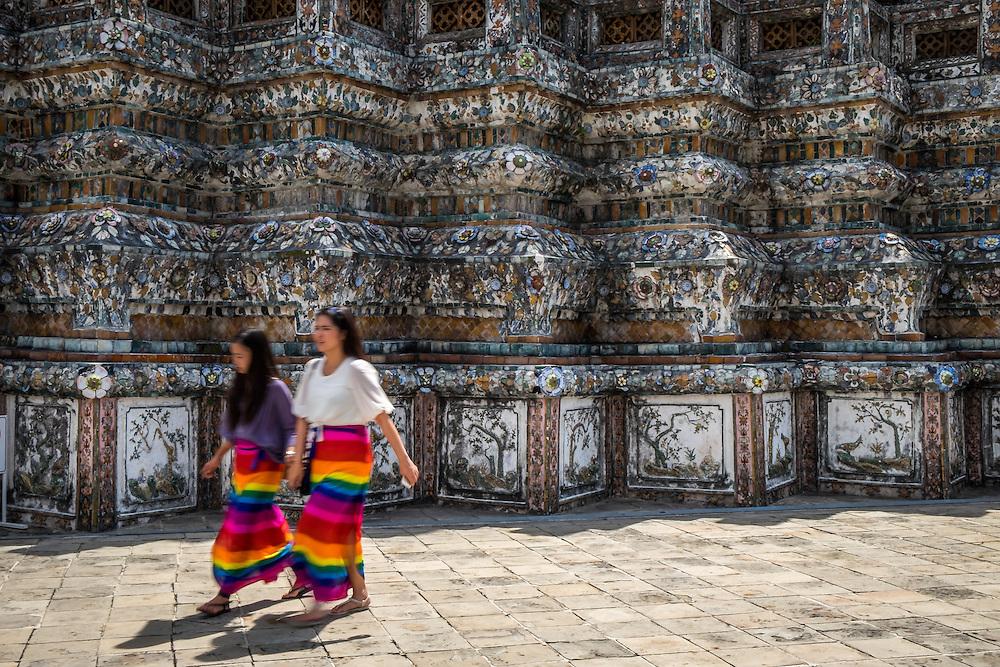 BANGKOK, THAILAND - CIRCA SEPTEMBER 2014: Thai women walking in Wat Arun, a  popular Buddhist temple in Bangkok Yai district of Bangkok, Thailand, on the Thonburi west bank of the Chao Phraya River