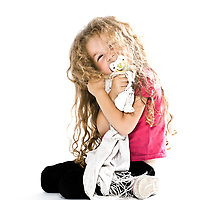 one caucasian little girl hugging blanket pacifier miling cheerful sitting on the floor isolated studio on white background