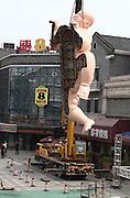 """JINAN, CHINA - AUGUST 05: <br /> <br /> The giant naked fat sculpture is tore down from the roof on August 5, 2016 in Jinan, Shandong Province of China. Two giant naked men sculptures named \""""Happy Fat\"""" were tore down from the building roofs again as they didn\'t confirm with some design specifications in Jinan. ©Exclusivepix Media"""
