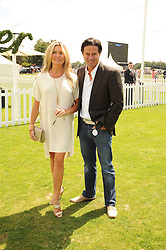 TINA HOBLEY and OLIVER WHEELER at the Cartier International Polo at Guards Polo Club, Windsor Great Park, Berkshire on 25th July 2010.