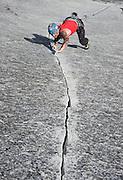 "Tim Grogan climbing the classic finger crack ""Mr. Natural"" on Glacier Point Apron, Yosemite Valley, California"