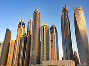 Dubai skyline at sunset featuring some of the unique skyscrapers that make Dubai so special
