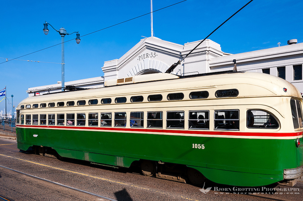 United States, California, San Francisco. A tram in front of Pier 35 at Fisherman's Wharf.