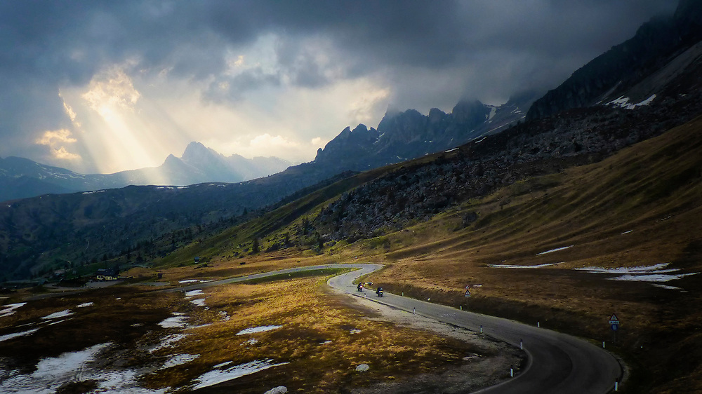 As afternoon turned to evening on Passo Giao in the Dolomite mountains of the Italian Alps, the light became beautifully dramatic.  We were able to capture several images that tell the story of this unique and amazing location.  Here, a pair of motorcyclists approach the top of the pass.
