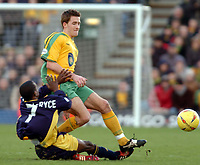 Picture: Henry Browne.<br />Date: 07/02/2004.<br />Wimbledon v Norwich City.<br /><br />Adam Drury of Norwich is challenged by Jamal Campbell Ryce of Dons.