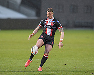 Kevin Brown (7) of Salford Red Devils kicks the ball