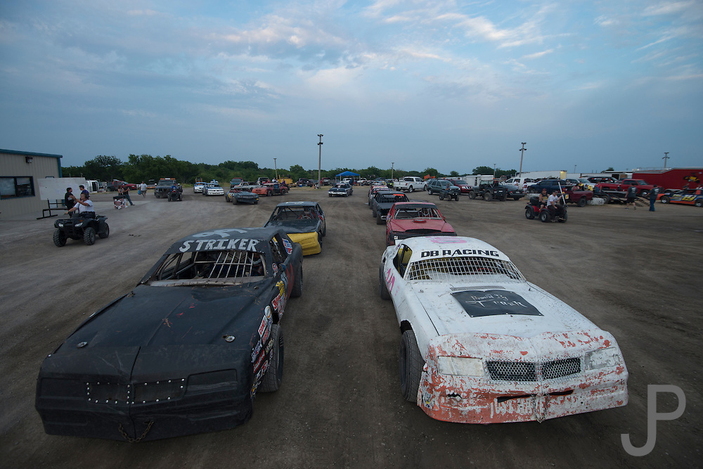 Stock cars wait to get on the racing track at Salina High Banks Speedway.