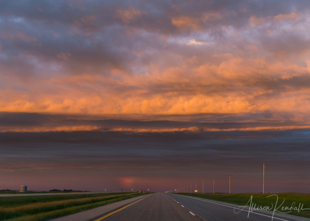 """A stunning summer sunset fills the sky above the open Saskatchewan landscape   Each 252-piece photo puzzle comes in a sturdy, finished cardboard box and measures 10"""" x 14"""" when complete"""