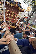 a Mikoshi Shrine being carried through the streets