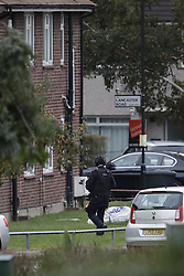 © Licensed to London News Pictures. 22/10/2016. London, UK. Armed police are seen in front of a house in Lancaster Road in Northolt. Police are surrounding the address after a report of concerns for the occupant and hazardous items inside the property. Police believe a man is still inside the house. Photo credit: Peter Macdiarmid/LNP