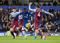 Football - 2019 / 2020 Premier League - Chelsea vs. West Ham United<br /> <br /> West Ham players surround Fikayo Tomori (Chelsea FC) as he tries for goal at Stamford Bridge <br /> <br /> COLORSPORT/DANIEL BEARHAM