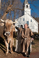 "Innkeeper Peter Ayer welcomes ""Chip"" prior to the Gilford Community Church Living Nativity scene presented at the Thompson Ames Historical Society on Sunday afternoon.  (Karen Bobotas/for the Laconia Daily Sun)"