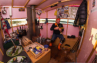 Rick Barton of Belmont checks over a tip up in his Bob House on Saunders Bay as he readies for the annual Great Meredith Rotary Fishing Derby this weekend.  (Karen Bobotas/for the Laconia Daily Sun)