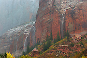Several temporary waterfalls cascade down Paria Point during a heavy storm in the Kolob Canyons section of Zion National Park, Utah.