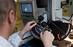 SOLMS, GERMANY - MAY-18-2009 - Leica technicians put every lens through a battery of rigorous tests. (Photo © Jock Fistick)