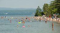 Beach goers flood to Ellacoya State Beach on Wednesday afternoon to cool off as the temperatures continue into the 90's.  (Karen Bobotas/for the Laconia Daily Sun)