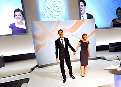 © Licensed to London News Pictures. 27/09/2011. LONDON, UK. David Miliband, Leader of the Labour Party, holds hands with his wife Justine after he delivers his Leader's Speech at The Labour Party Conference in Liverpool today (27/09/11). Photo credit:  Stephen Simpson/LNP