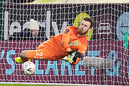 Burnley goalkeeper Will Norris (25) saves a penalty during the FA Cup match between Burnley and Milton Keynes Dons at Turf Moor, Burnley, England on 9 January 2021.