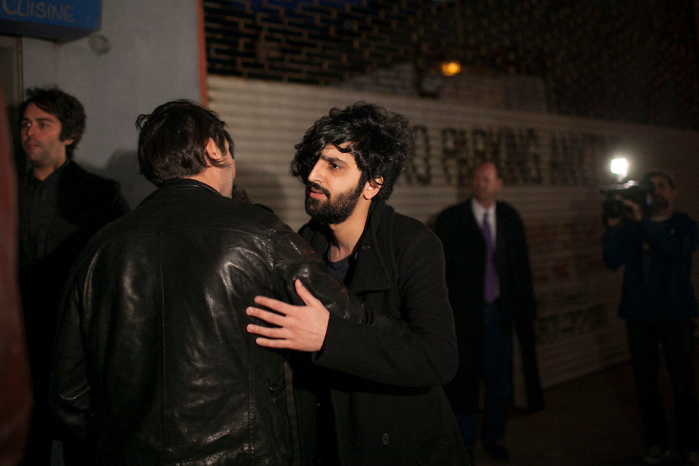 Yellow Dogs band member Koory Mirzaei, center, arrives to a candlelight vigil for the Yellow Dogs, the band whose members were killed last week, at Cameo Gallery, 93 North 6th Street in the Williamsburg neighborhood of Brooklyn, NY on Monday, Nov. 18, 2013.<br /> <br /> Photograph by Andrew Hinderaker