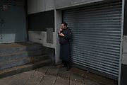 Chef worker on a cigarette break by some shutters in London, England, United Kingdom. (photo by Mike Kemp/In Pictures via Getty Images)