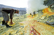 The pipes lead the suture fumes down toward the ground where it cools and becomes liquid, then a solid.  The sulfur is then collected and carried out by dozens of workers.