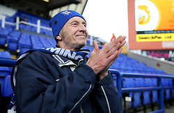 A Birmingham City fan in the stands gets ready to face Brentford before the match at St Andrew's Trillion Trophy Stadium